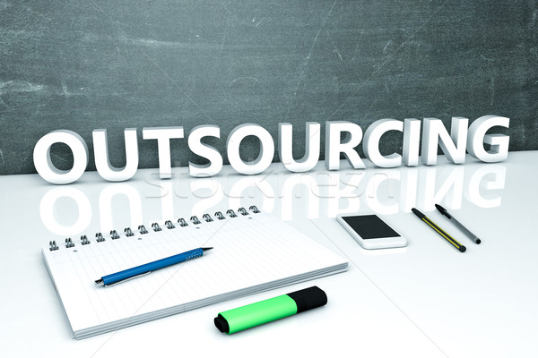 Outsourcing tekst schoolbord notebook pennen mobiele telefoon Stockfoto © Mazirama