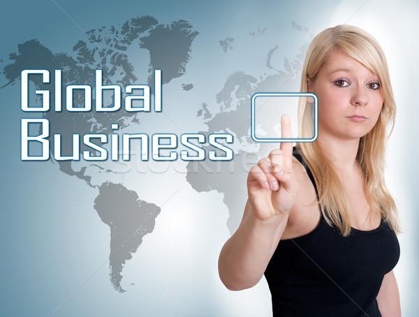 Commerce mondial jeune femme presse numérique bouton interface Photo stock © Mazirama
