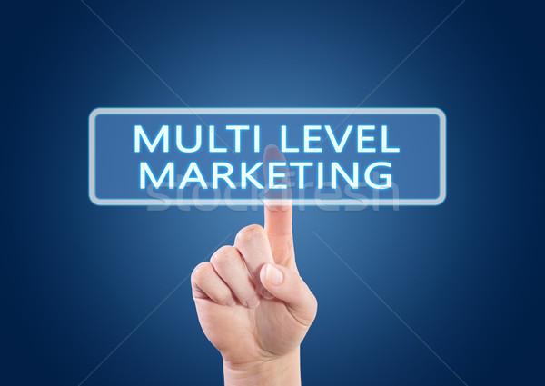 Niveau marketing main bouton interface Photo stock © Mazirama
