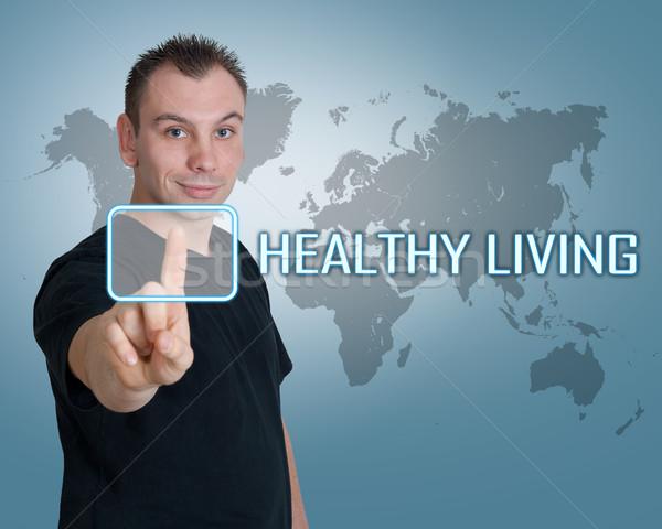 Gezond leven jonge man druk knop interface gymnasium Stockfoto © Mazirama