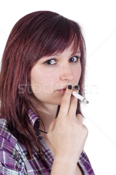 Dohányzás nő fiatal piros cigaretta izolált Stock fotó © Mazirama