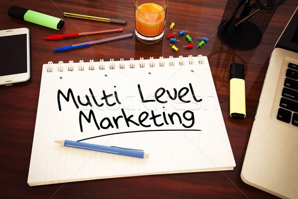 Nível marketing texto caderno secretária Foto stock © Mazirama