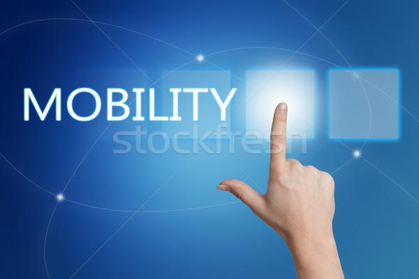 Mobilité main bouton interface bleu Photo stock © Mazirama