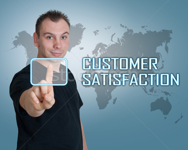 Satisfacción del cliente joven prensa digital botón interfaz Foto stock © Mazirama