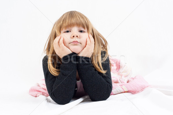 Kislány kicsi szőke nő lány hazugság fehér Stock fotó © Mazirama