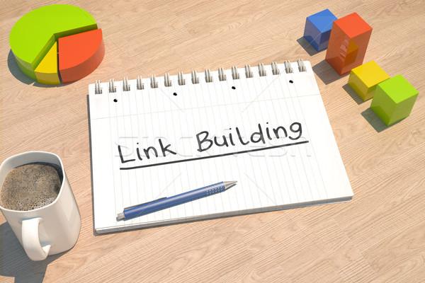 Link edifício texto caderno caneca de café gráfico de barras Foto stock © Mazirama