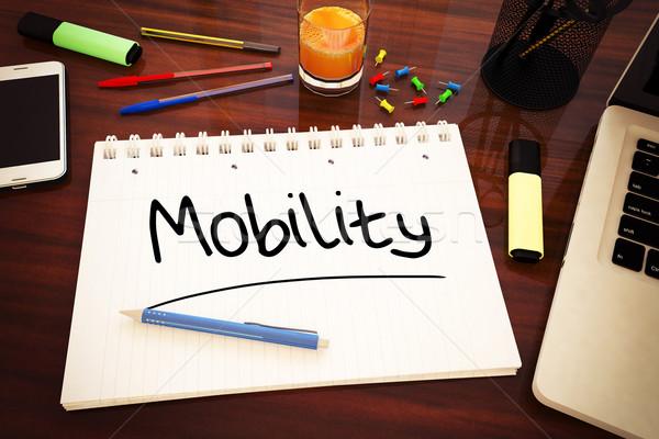 Mobilità manoscritto testo notebook desk rendering 3d Foto d'archivio © Mazirama