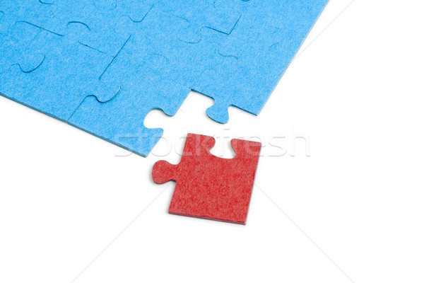 Blue Puzzle with one red jigsaw piece isolated on white backgrou Stock photo © Mazirama