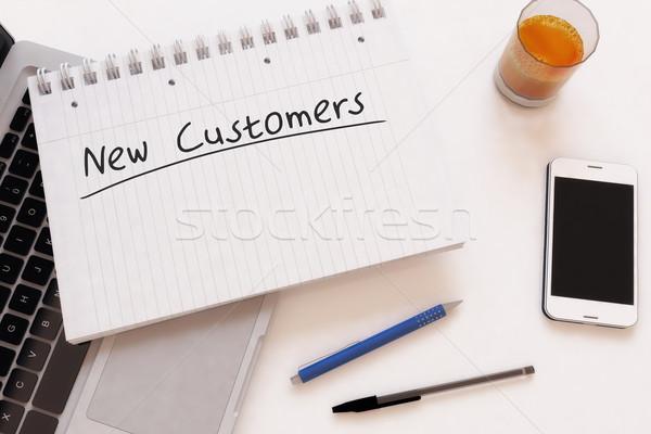 Stock fotó: új · vásárlók · kézzel · írott · szöveg · notebook · asztal