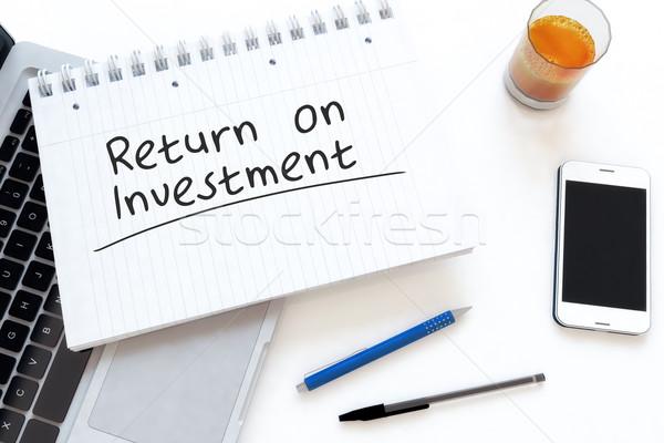 возврат инвестиции текста ноутбук столе Сток-фото © Mazirama