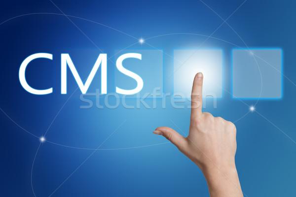 Conteúdo gestão cms mão botão Foto stock © Mazirama