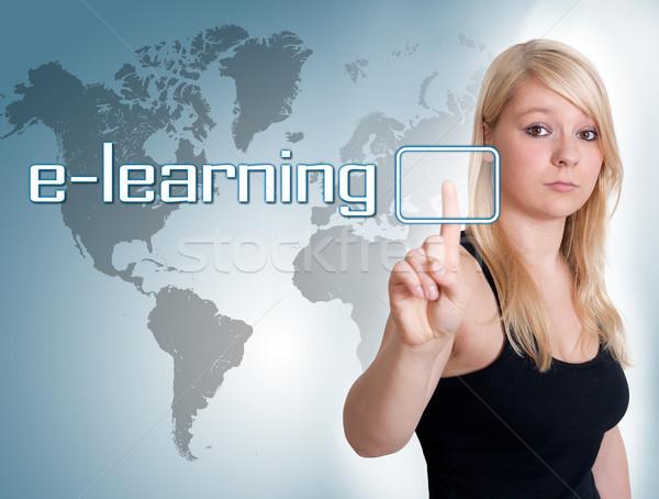 Online oktatás fiatal nő sajtó digitális gomb interfész Stock fotó © Mazirama