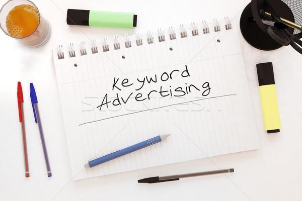 Palabra clave publicidad texto cuaderno escritorio Foto stock © Mazirama