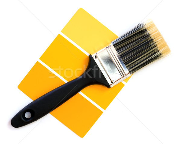 Stock photo: yellow color swatch with paintbrush