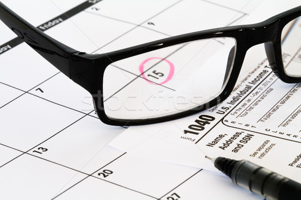 1040 tax form with calendar glasses and pen Stock photo © mblach