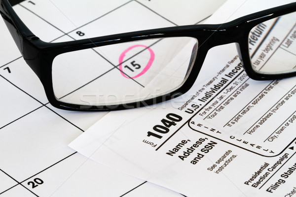 1040 tax form with calendar glasses Stock photo © mblach