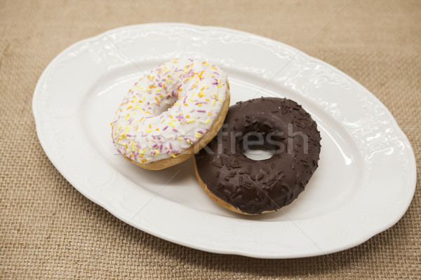 Fresh juicy sweet pastries donuts on a dark background. Stock photo © mcherevan
