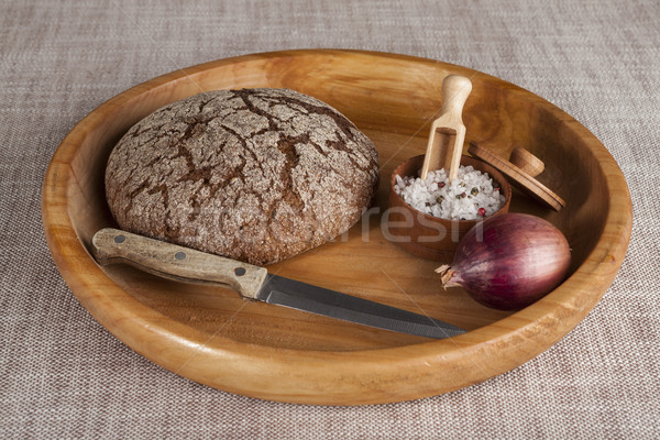 Fresh homemade bread made  with a jar of salt, a knife and onion.  Stock photo © mcherevan