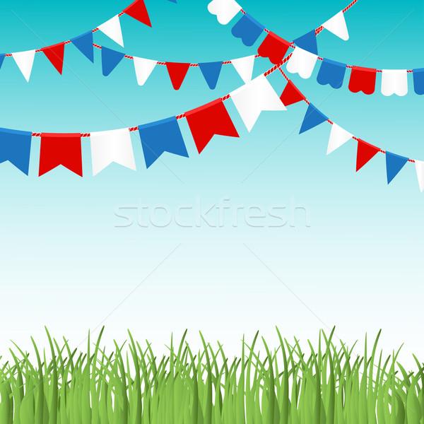 Blauwe hemel groen gras kleurrijk vlaggen Rood Blauw Stockfoto © mcherevan