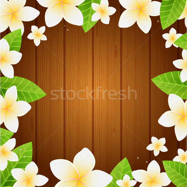 White frangipani flowers and leaves on the wooden background - spa background.  Stock photo © mcherevan