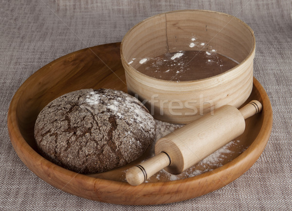 Fresh homemade bread made with a sieve for flour and a rolling pin. Stock photo © mcherevan