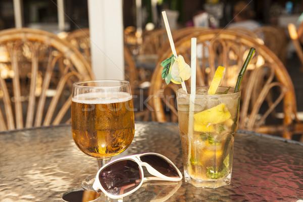 üveg sör mojito olajbogyók asztal háttér Stock fotó © mcherevan