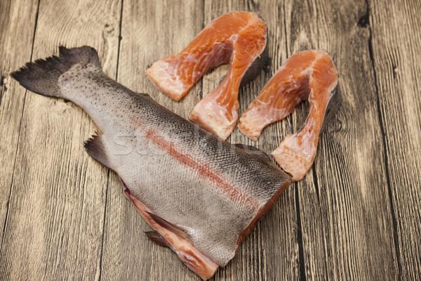 Fresh Norwegian rainbow trout steaks lying on the wooden background Stock photo © mcherevan