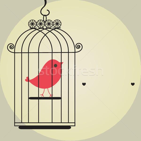 Cute bird in birdcage Stock photo © mcherevan