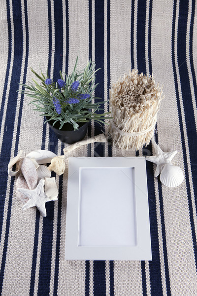 Beautiful collage with white photo frame on old vintage rug. Stock photo © mcherevan