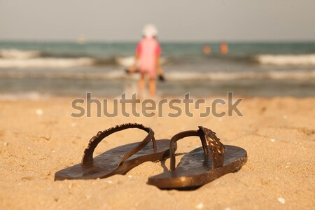 415115376  6092677 Flip-flop on sand beach of Lake Balaton by mcherevan Stock photo