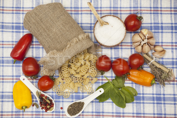 Stock photo: Rotelle  Italian pasta set for the creation : cherry tomatoes, olive oil, balsamic sauce, garlic, sp