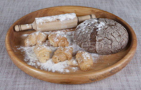 Fresh homemade bread made with  a rolling pin and pastry rolls with jam. Stock photo © mcherevan