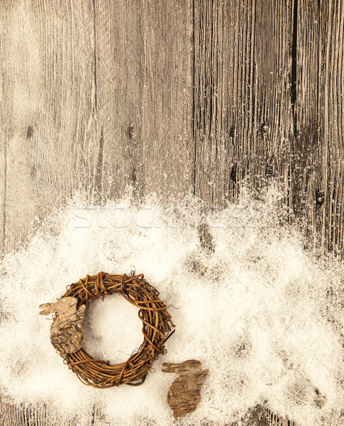 Christmas card with wreath and little hare from birch bark on a wooden background. Stock photo © mcherevan