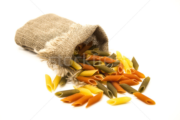 Beautiful Italian pasta Penne rigate  from durum wheat  in a linen sack, closeup on a white backgrou Stock photo © mcherevan