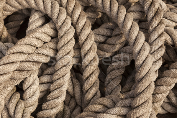 Older intricate marine ropes closeup. Stock photo © mcherevan