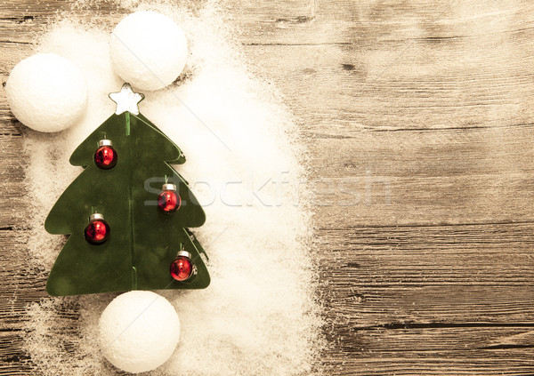 Postcard with a Christmas tree ,Christmas balls snowballs and snow on wooden background Stock photo © mcherevan