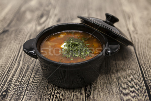 Stock photo: Tomato red pepper soup, sauce with olive oil, rosemary and smoked paprika in a beautiful ceramic pot