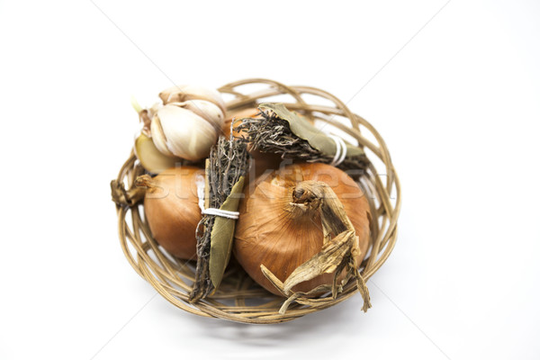 Spice set in wicker basket onion, Provence herbs, garlic on a white background. Stock photo © mcherevan