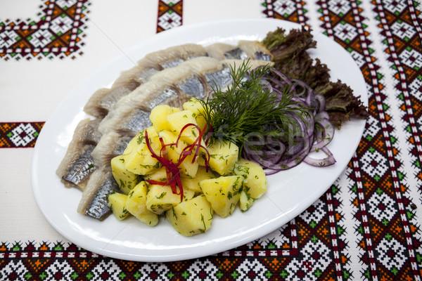 Dish with fresh Norwegian herring with potatoes and fresh onions. Stock photo © mcherevan