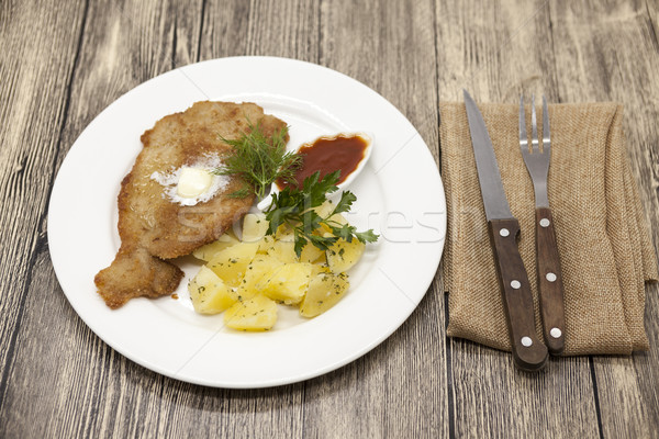Petite Wiener schnitzel with boiled potatoes and ketchup. Served on a white porcelain plate with for Stock photo © mcherevan