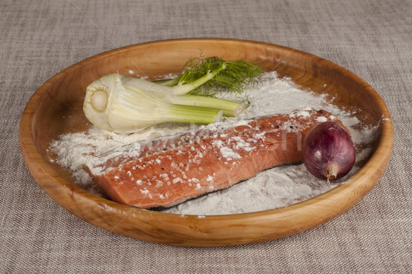 Fresh raw salmon on a wooden tray with parsley, salt and celery. Stock photo © mcherevan