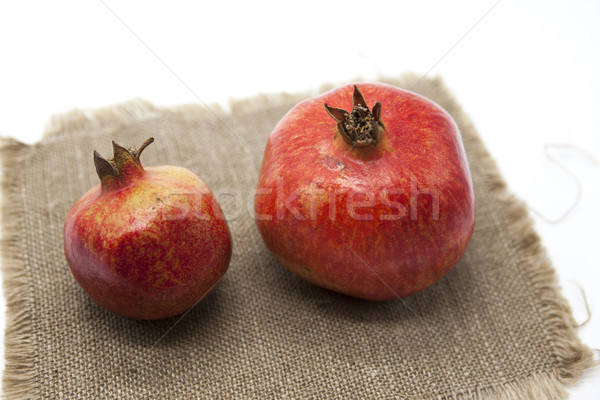 Pomegranates have broken into pieces with red berries on background Stock photo © mcherevan