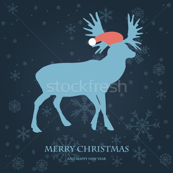Christmas card with reindeer in Santa hat. Stock photo © mcherevan