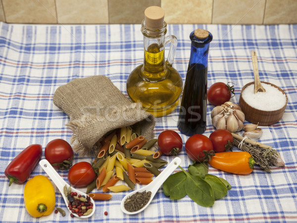 Penne rigate Sicilian pasta set for the creation : cherry tomatoes, olive oil, balsamic sauce, garli Stock photo © mcherevan