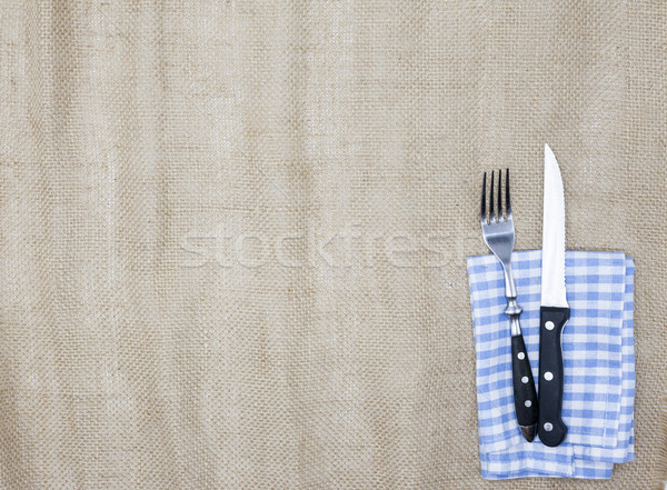 Canvas tablecloth, fork, knife for steaks and napkin. Is used to create a menu for a steak house. Th Stock photo © mcherevan
