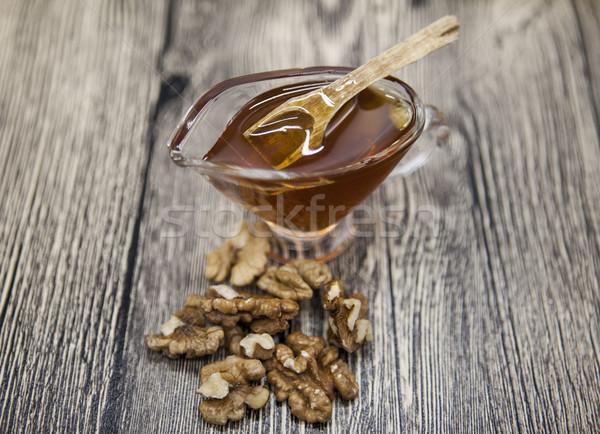 Glas vaas honing walnoot Stockfoto © mcherevan