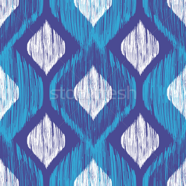 Ethnic modern tribal ikat blue, white and navy fashion seamless pattern. Vector ikat background. Stock photo © mcherevan