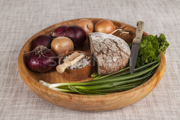 Onions, brown bread wooden tray with parsley and salt and celery ,knife Stock photo © mcherevan