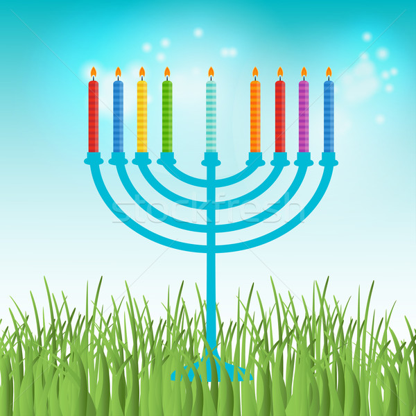 Hanukkah menora with  candles on blue sky and green grass background Stock photo © mcherevan