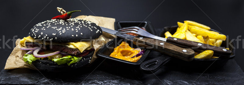 Set of the black burger. Stone plate with: black burger roll slices of juicy marble beef, fused chee Stock photo © mcherevan